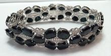 App. 10,700  100.70ct w/40 Blue Sapphire, Colorless Topaz 2.52 cts Silver plated Bracelet