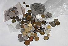Old purse filled with coins in circulation, while Bolivia, Brazil, Belgium, much England