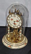 Table pendulum clock with flower decoration, from the brand