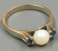 Ladies ring from the 585th white gold, takes with 1 pearl flanked from 2 sapphires