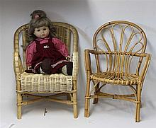 2 antique doll wicker chairs , with a doll