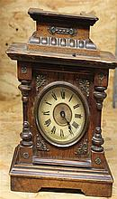 1 small table clock made ??of wood with musical mechanism