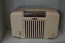 A GOLDEN VOICE BAKELITE RADIO