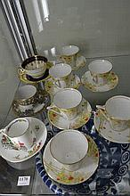SEVEN DECO DEMITASSE CUPS AND SAUCERS, AN AYNSLEY AND STAFFORDSHIRE CROWN