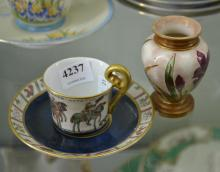 A HAND PAINTED LIMOGES CUP AND SAUCER, AND A ROYAL DOULTON VASE