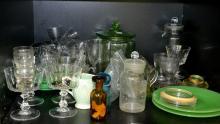 A SHELF OF GLASSWARE, INCLUDING URANIUM