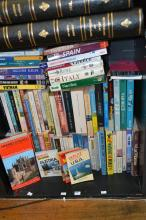 A SHELF OF TRAVEL WRITING AND GUIDES