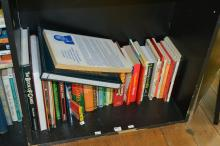 A SHELF OF BOOKS ON GAMES AND TRIVIA