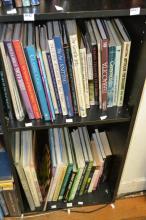 A SHELF OF BOOKS RELATING TO GOLF