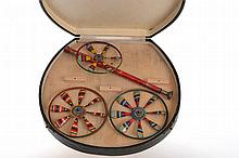A BOXED VINTAGE TIN PLATE 'SPINNING TOP' TOY
