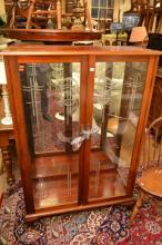 AN ANTIQUE-STYLE ECCLESIASTICAL ENGRAVED GLAZED BOOKCASE (A/F TO LEG)