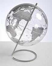 A CONTEMPORARY CLEAR WORLD GLOBE ON STAND