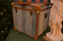 A LARGE STORAGE BOX, UPHOLSTERED IN BLUE STRIPED DHURRIE