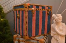 A LARGE STORAGE BOX, UPHOLSTERED IN BLUE AND MAGENTA STRIPED DHURRIE