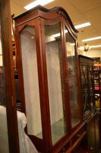 AN ANTIQUE-STYLE DISPLAY CABINET
