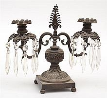 A 19TH CENTURY PATINATED CAST METAL TWO BRANCH TABLE CANDELABRA