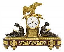A LOUIS XVI ORMOLU, GILT BRONZE, BRONZE AND ROUGE GRIOTTE MARBLE STRIKING MANTEL CLOCK