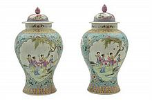 A SIMILAR PAIR OF CHINESE FAMILLE ROSE ENAMELLED VASES AND COVERS