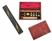 A LATE 19TH CENTURY MAHOGANY CASED SIKES' HYDROMETER WITH HYDROMETER TABLES BOOK; AND A BRASS AND EBONY SLIDE RULE