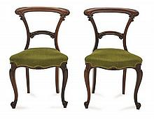 A SET OF EIGHT VICTORIAN ROSEWOOD SADDLE BACK DINING CHAIRS
