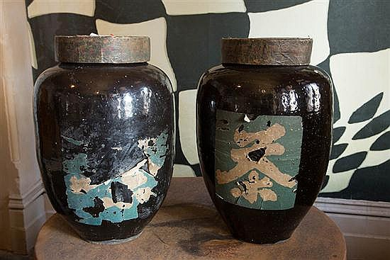 A PAIR OF LARGE BLACK ENAMELLED JAPANESE STONEWARE JARS