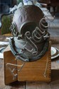AN ANTIQUE PEARL DIVER'S HELMET