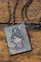 A NECKLACE DESIGNED BY DAVID BROMLEY WITH PENDANT OF A PIRATE GIRL