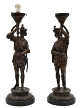 A PAIR OF CONTIENTAL SPELTER FIGURAL LAMPS