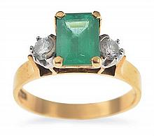 A THREE STONE EMERALD AND DIAMOND RING