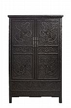 A WELL CARVED ROUND CORNER HARDWOOD SLOPING STILE 'YUANJIAOGUI' CABINET