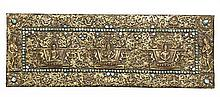 A TIBETAN GILT COPPER REPOUSSE ON WOOD BOOK COVER, 16TH CENTURY