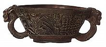 A CHINESE CARVED HORN CUP WITH HORNLESS DRAGON HANDLES