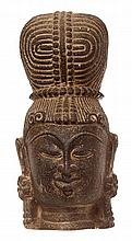 A STONE HEAD OF BUDDHA WITH ORNATE TOWERING HAIR BUN