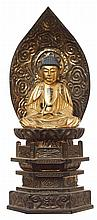 A JAPANESE 20TH CENTURY GILT AND LACQUER WOOD KANNON BODHISATTVA