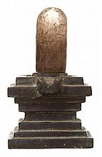 AN INDIAN ROCK CRYSTAL SHIVA LINGA ON BRONZE STAND