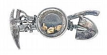 A MINERS BROOCH