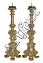 A PAIR OF 18TH CENTURY FRENCH GILTWOOD TORCHERESEach with a facetted stem carved with acanthus leaves, above a tripartite base, rai...