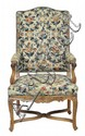 A LOUIS XV WALNUT FRAMED TAPESTRY UPHOLSTERED ARMCHAIRWith a shaped rectangular back above upholstered arms and a fitted seat, rais...