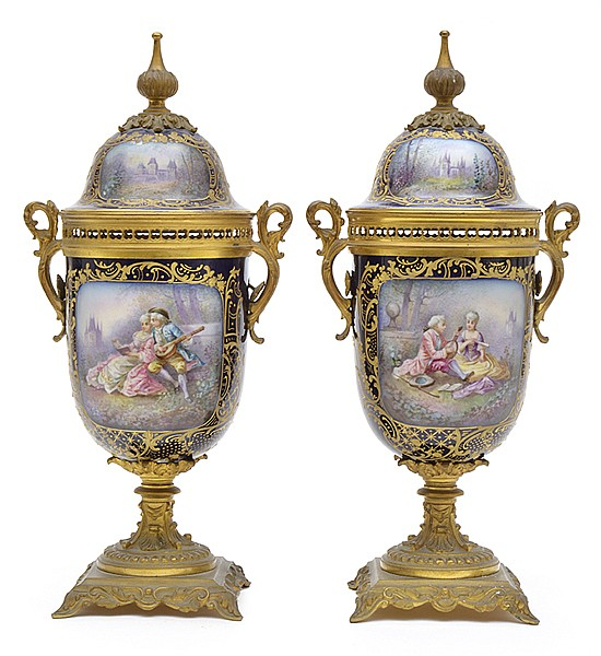 A PAIR OF SEVRES STYLE GILT METAL MOUNTED PORCELAIN URNS 19TH CENTURY