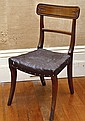 A SET OF THREE REGENCY SABRE LEG SPADE BACK DINING CHAIRS