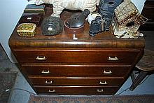 AN ART DECO FOUR DRAWER CHEST OF DRAWERS