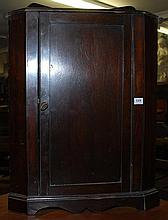 A SINGLE DOOR MAHOGANY CORNER CUPBOARD, 42 x 58 x 28