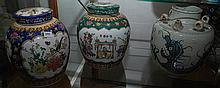 A PAIR OF CHINESE ENAMEL GINGER JARS, 23 cm height, WITH A BLUE AND WHITE PROCELAIN VASE WITH DRAGON DECORATION