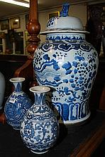 A BLUE AND WHITE CHINESE GINGER JAR, AND A PAIR OF BLUE AND WHITE VASES WITH PHEONIX DECORATION