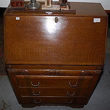 A THREE DRAWER OAK DESK, 77 x 107 x 46