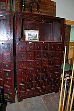 AN IMPRESSIVE CHINESE APOTHECARY STORAGE UNIT WITH THIRTY-NINE DRAWERS AND AN OPEN DISPLAY SHELF, 123 x 210 X 57