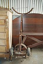 A MILITARY CAST IRON TROLLEY