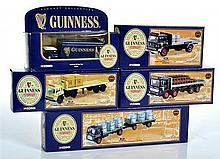 FIVE CORGI GUINNESS LORRIES, 20902 LEYLAND ERGOMATIC PLATFORM LORRY WITH BOTTLE CRATES; 22503 BEDFORD TK ARTICULATED PLATFORM TRAILE...