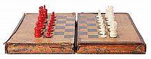 A VICTORIAN CHESS AND BACKGAMMON FAUX BOOK GAMES BOARD, CONTAINING SETS AND SHAKERS, CIRCA 1850