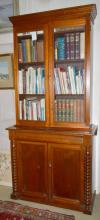 A VICTORIAN CEDAR BOOKCASE, WITH TWO GLAZED UPPER DOORS AND TWO SOLID PANELLED LOWER DOORS, 108 X 228 45 CM